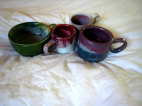 my first four handspun porcelain mugs :)
